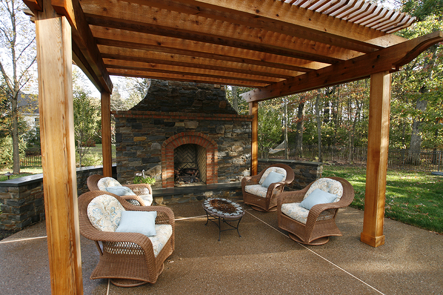 pergola and stone fireplace seating area