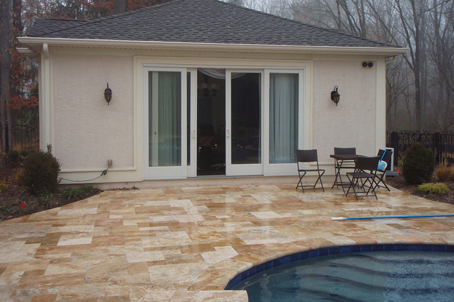 fully enclosed pool house with sliding glass doors
