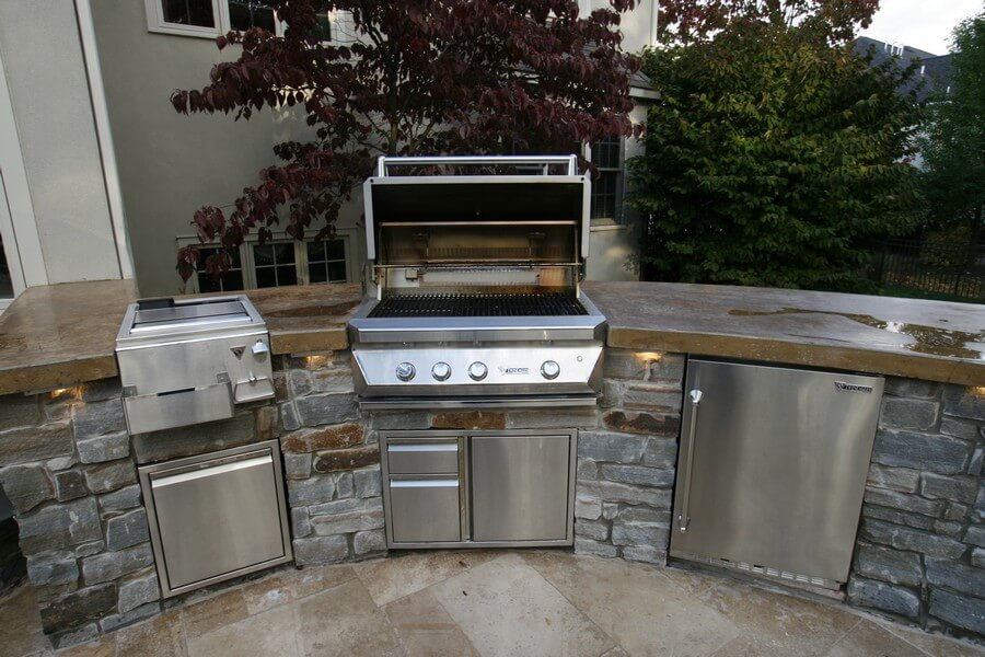 outdoor gas grill, refrigerator, trash compactor, and sink