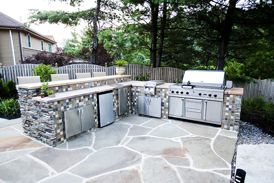 outdoor stone grill station with bar seating