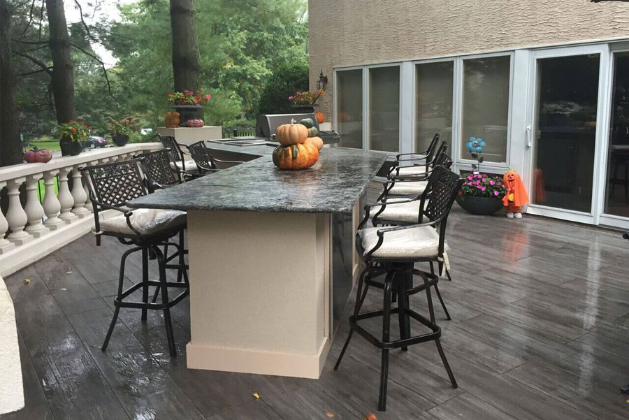 deck with bar and seating island