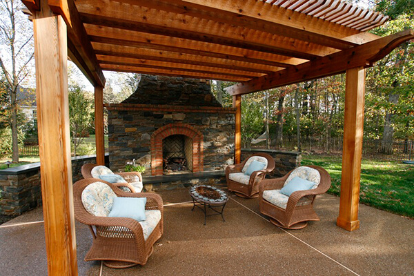 seating by outdoor fireplace and open cabana